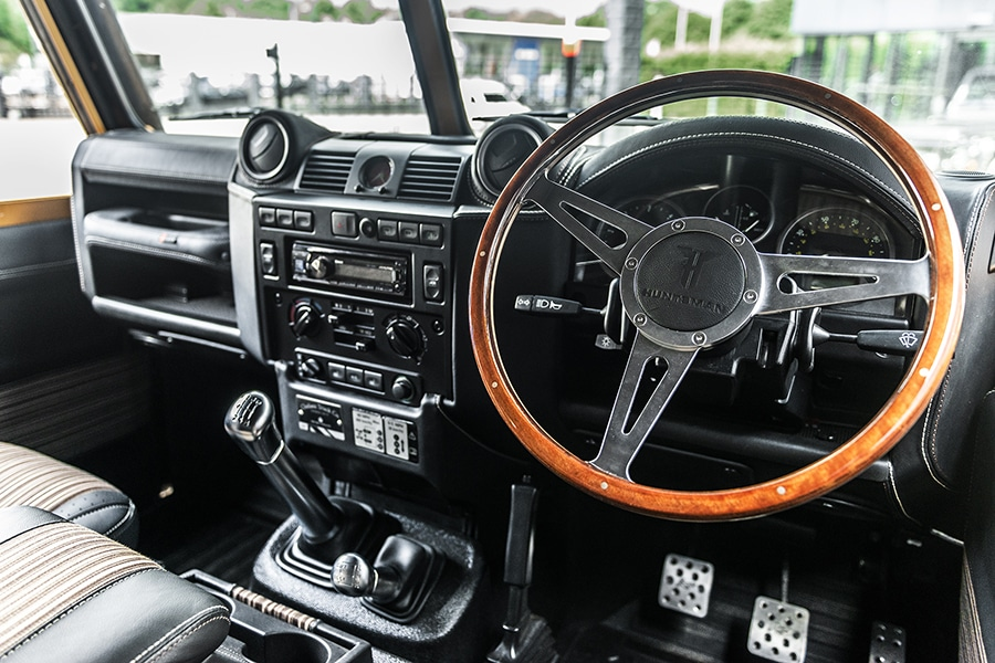 land rover steering wheel and dashboard of defender vehicle