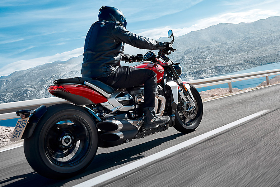 2020 Triumph Rocket 3 on the road riding by a man