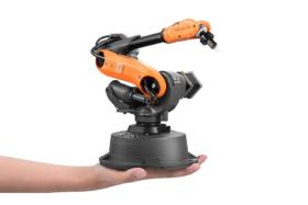 A hand holding Microbot 6 axis robot
