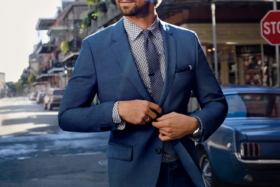 A model buttoning coat of blue suit