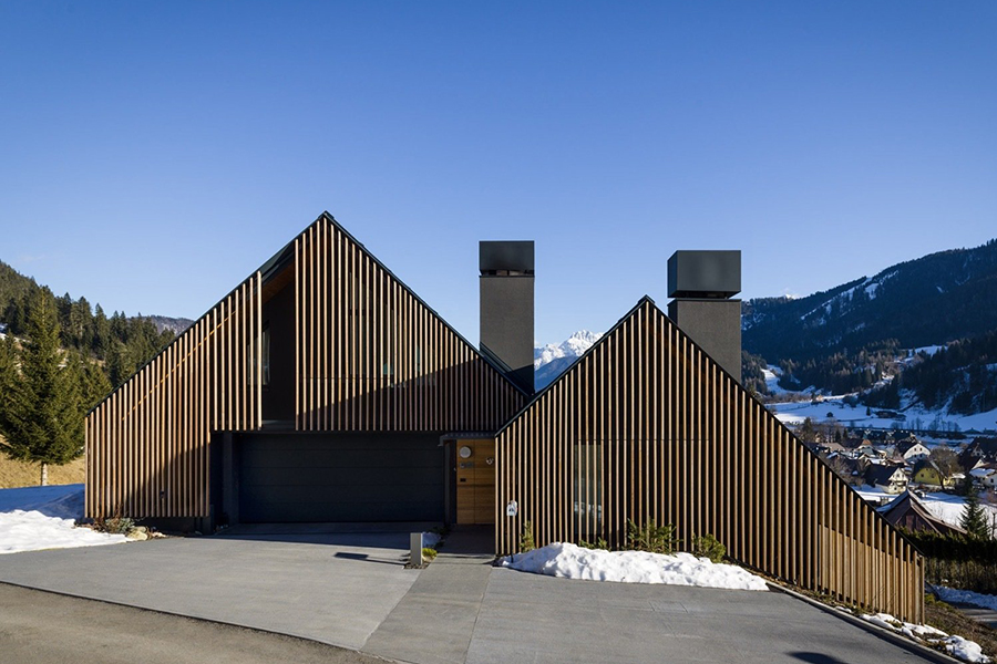 italian alpine home with interior wood in slopped design