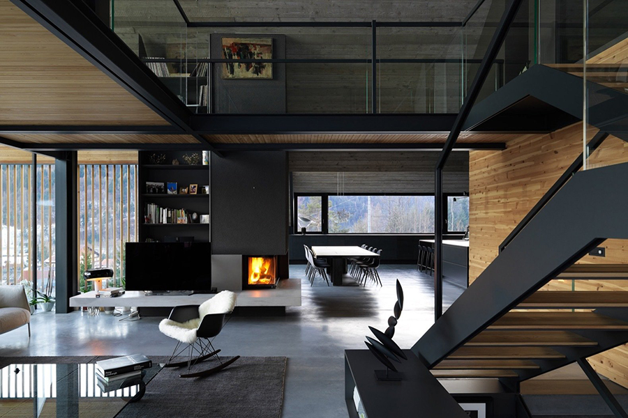 italian alpine home glass-walled bridge a living space and upper floor