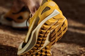 Closeup of the lifted heel ofNike x GYAKUSOU Nike Air Zoom Pegasus 36 from back
