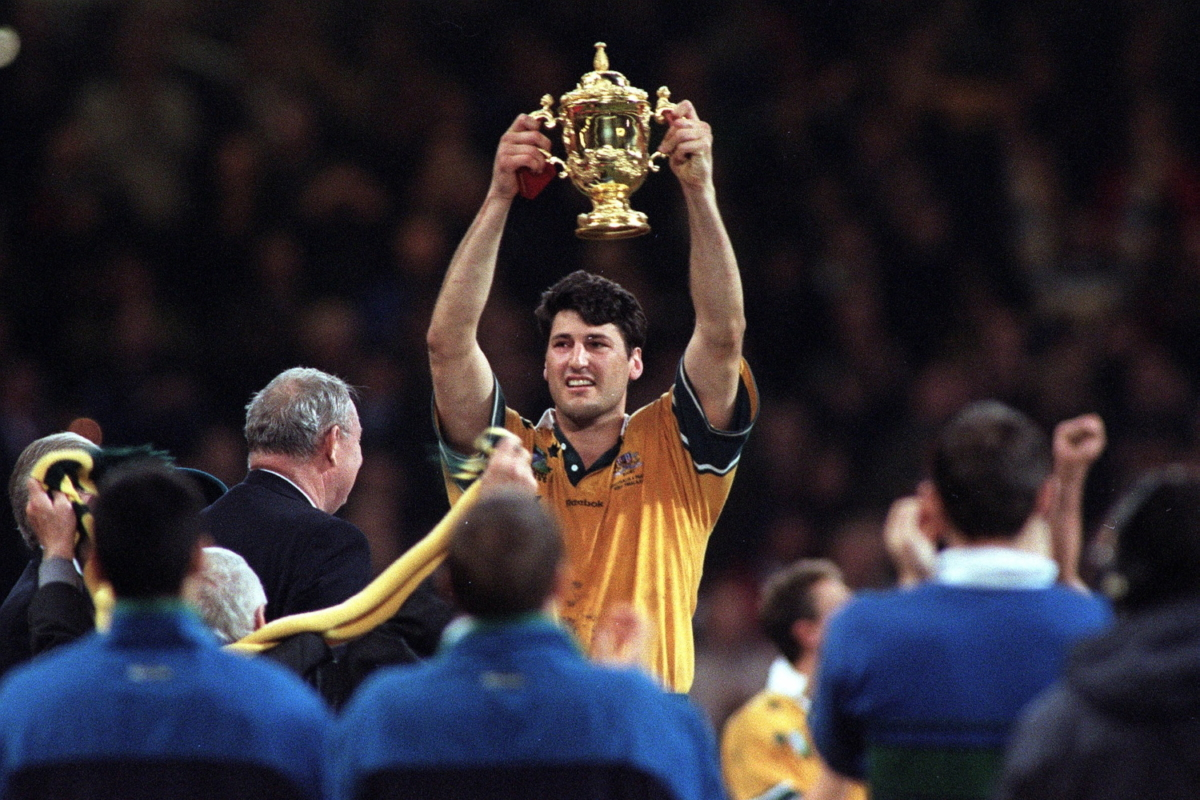 John Eales lifts the Web Ellis Cup after his Australia side defeated France