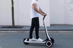 Side of a man on Segway Kickscooter