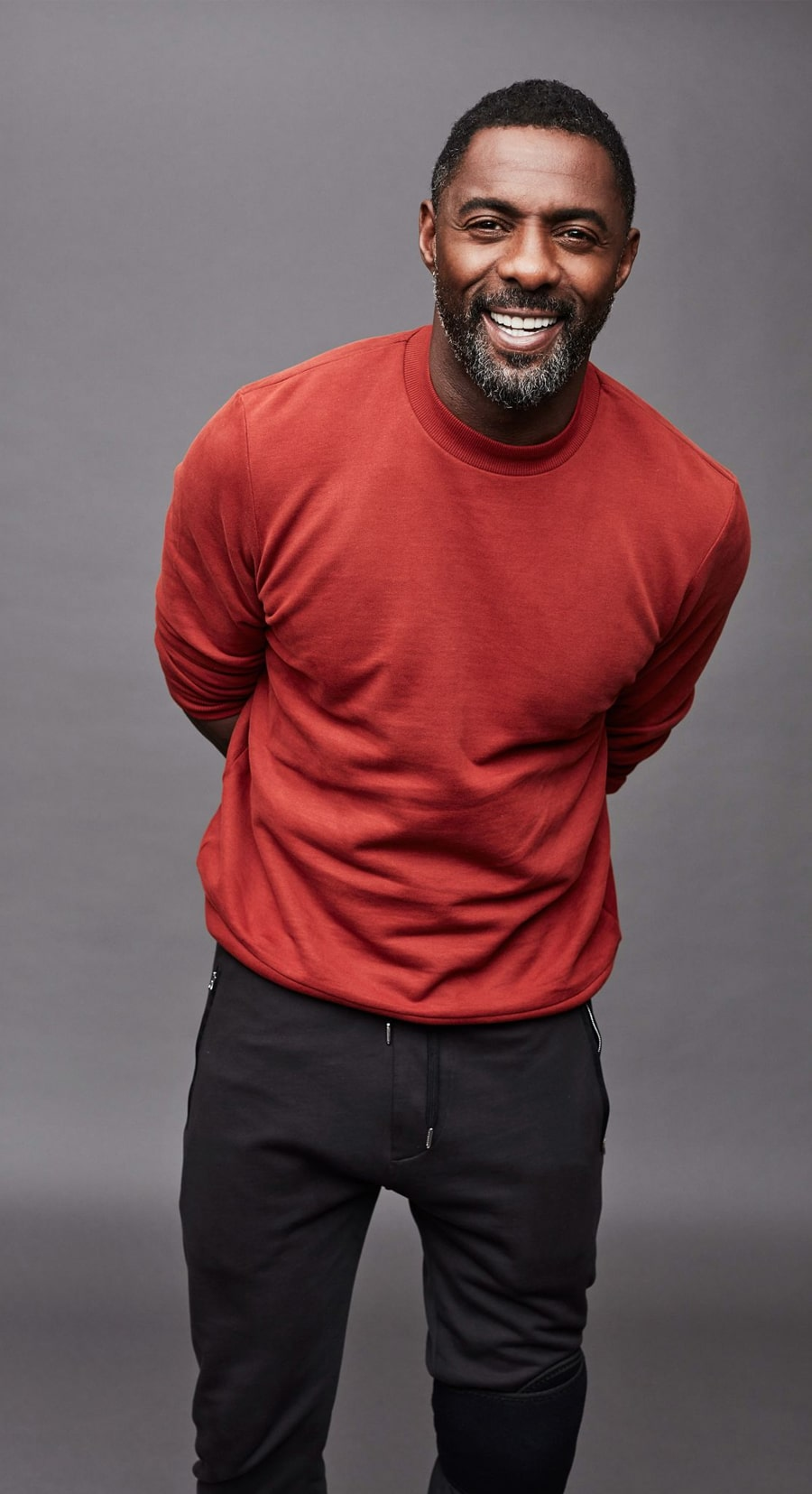 Idris Elba in red sweater