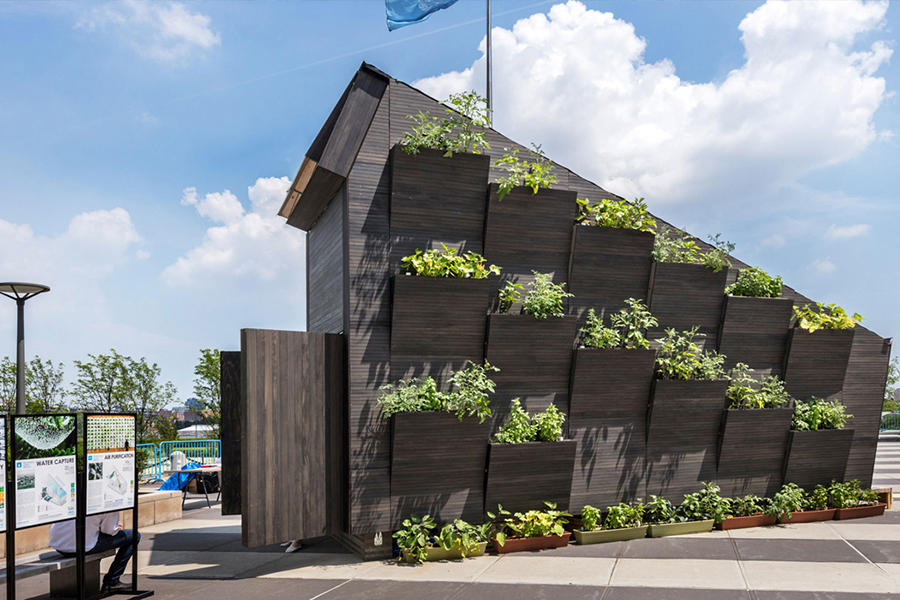 Tiny Home for Microliving with plants on the side