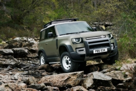 New Land Rover Defender on rocks