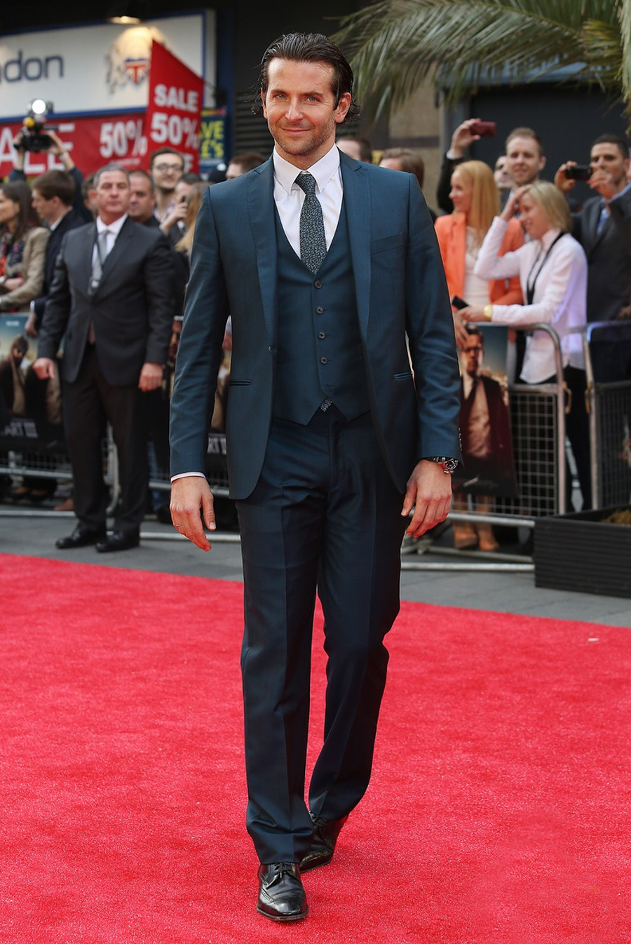 Bradley Cooper in a gray suit at a red carpet