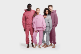 Four models wearing hooded t-shirts and pyjamas