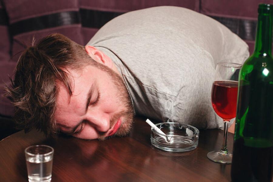 A drunk man sleeping on table