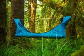 A blue Haven Hammock tent