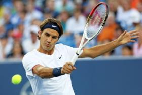 Roger Federer hitting a tennis ball