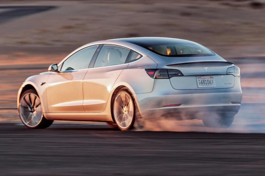 Tesla Model 3 rear three quarter in motion
