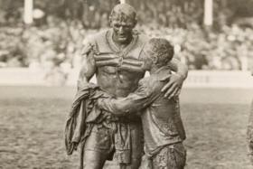 St George captain Norm Provan and Western Suburbs counterpart Arthur Summons' mud-caked embrace