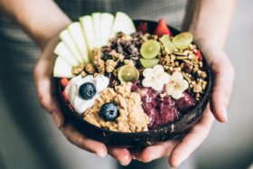 Pair of hands holding an Acai bowl