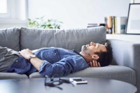 A man sleeping on a sofa