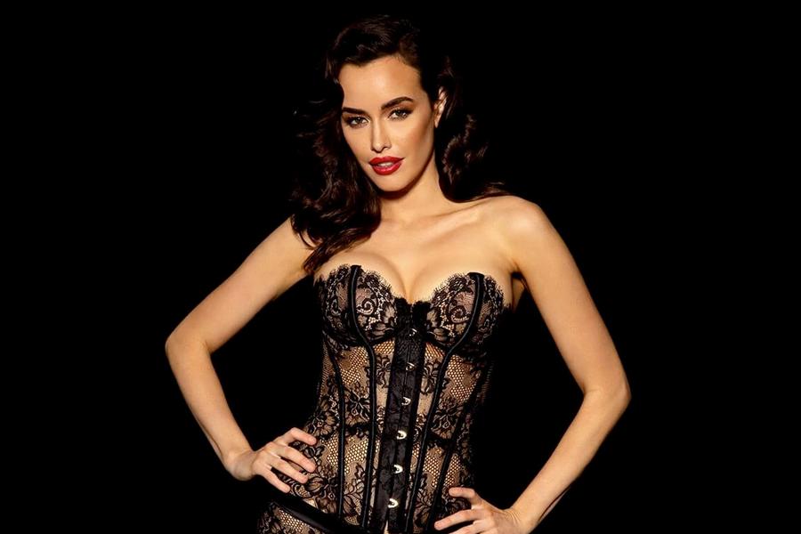 A model in black lace lingerie