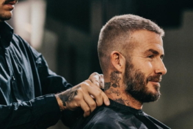 Side of a man getting a haircut
