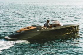 A man drivingHermes Speedster Boat