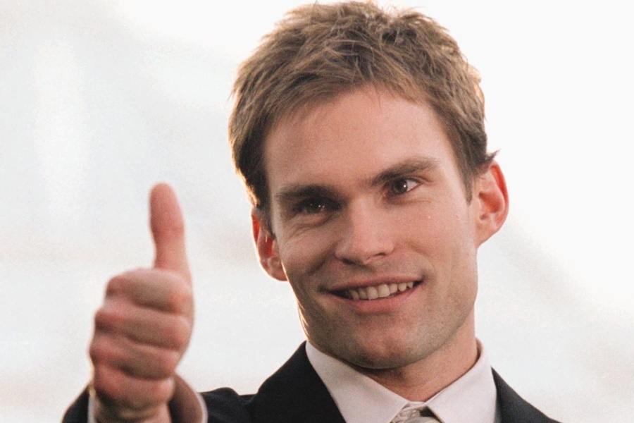 A man showing a thumbs up
