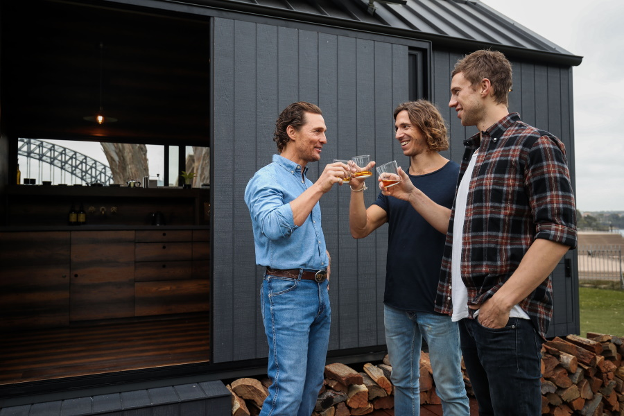 Matthew McConaughey and two men toasting with glasses