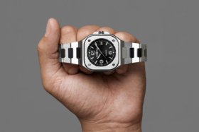 A fist with Bell & Ross BR05 watch on fingers