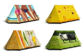 Four Field Candy tents with women's bottom half in bikini panties, cheese, sandwich and sheep on grass