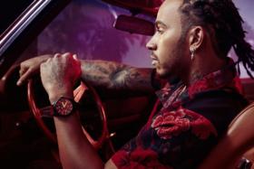 Lewis Hamilton on driving seat wearingIWC Big Pilot Perpetual Calendar watch
