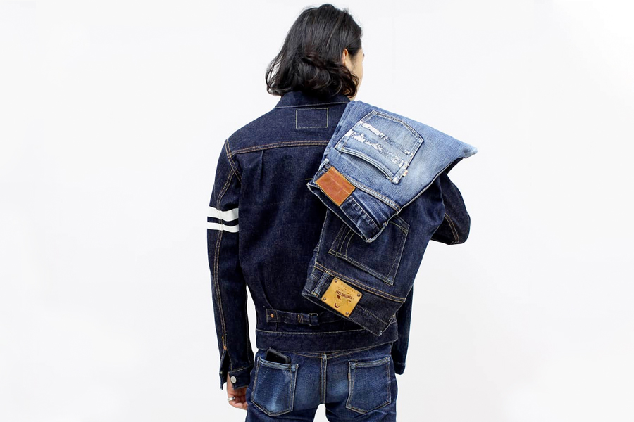 Back of a man with two jeans on his shuolder