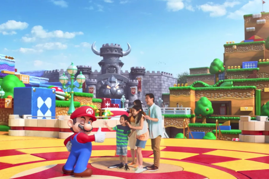 A graphic of a family with Mario at Super Mario World Japan i