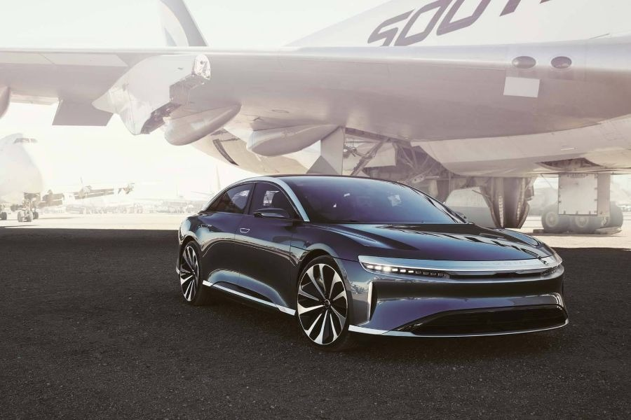 Lucid Air with a plane in background
