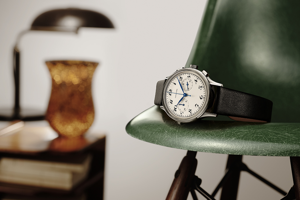 Longines Heritage Classic Chronograph 1946 on a green plastic chair