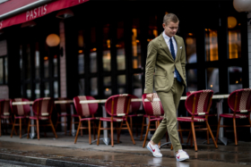 Man in a green suit with white sneakers
