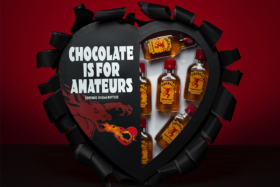 """Black heart pack of 10 50 ml bottles of Fireball whiskey with """"Chocolate is for amateurs"""" printed on it"""
