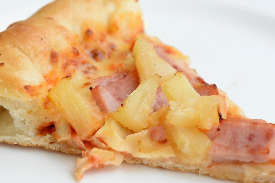 a slice of pizza with pineapple toppings