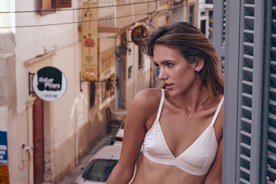 A girl in white bralette top in a balcony