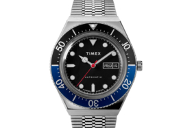 Dial of Timex M79 Automatic Batman watch with Black dial and half blue / half black bezel