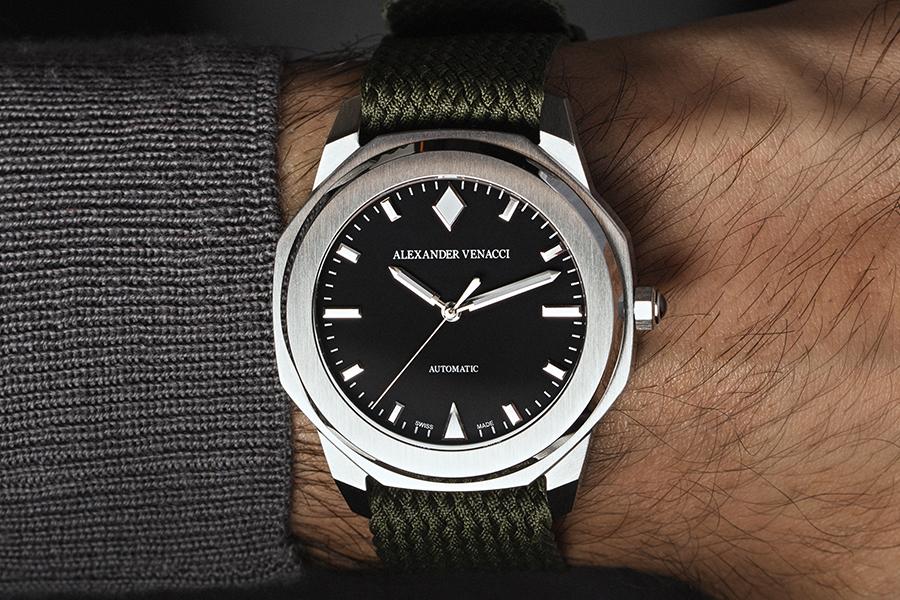 Alexaner VenacciBlack Dial and silver bezel watch on a wrist