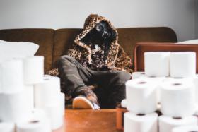 Man leopard print hoodie fur coat wearing a gas mask