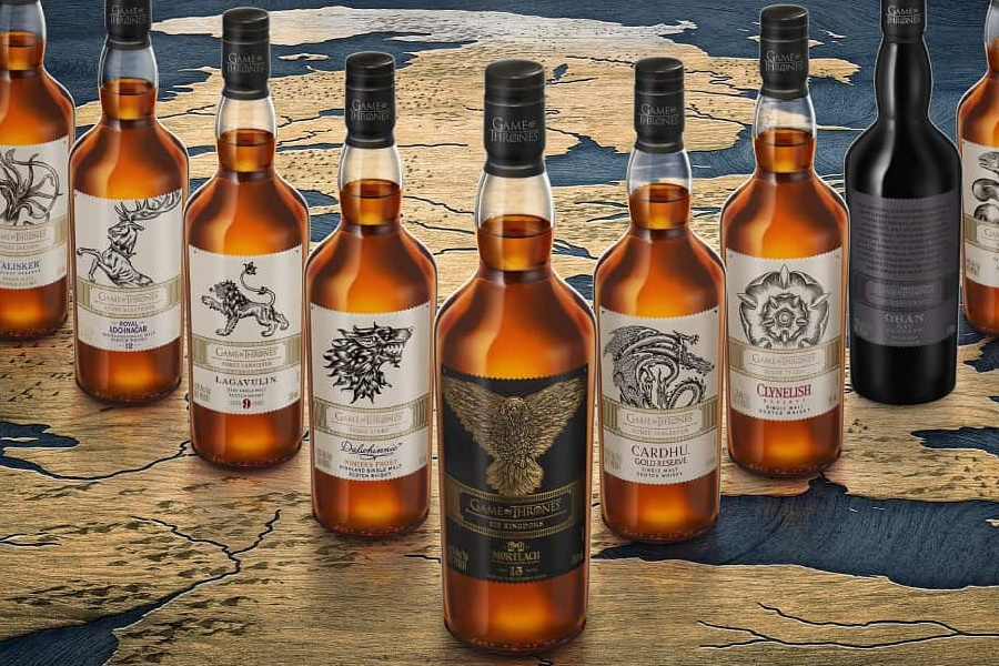 Bottle of Mortlach Single Malt Scotch Whisky with other eight Game of Thrones whiskey bottles