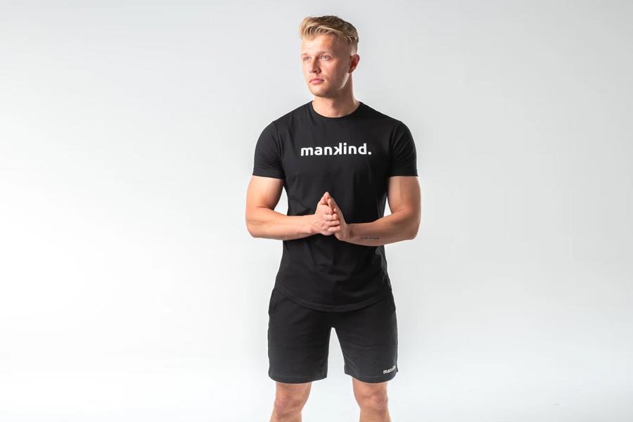 A model in Mankind Tech Tee