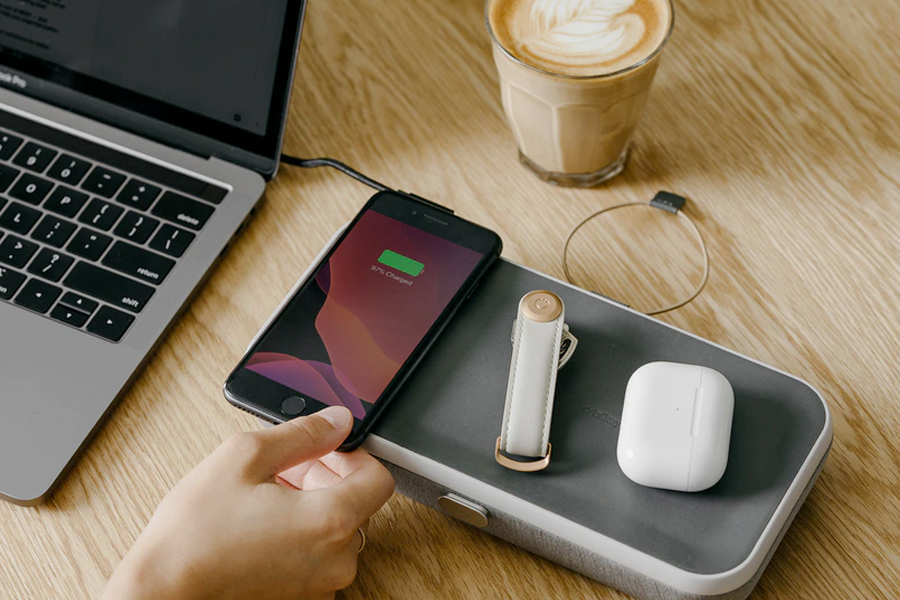 Phone, airpods case, and keyholder on Orbit Key Nest