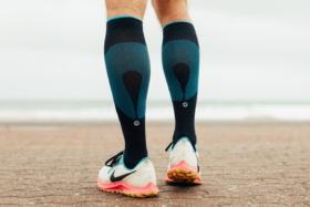 Back of two legs wearing Rockay Vigor Performance Socks