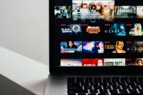 A laptop with Netflix homescreen open
