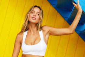 A girl in a white bikini top