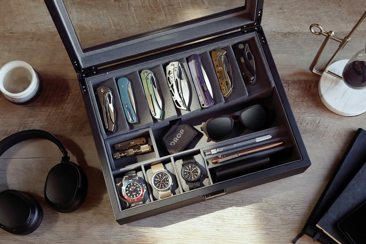 Drop Cache Display Valet filled with knives, sunglasses, watches, pens and wallet
