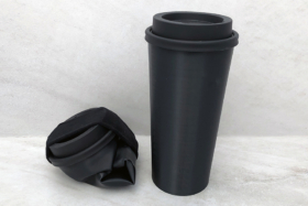 A collapsed and a standing black CWB Cup