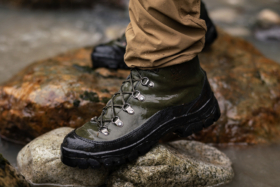 Legs wearing Filson x Danner Combat Hiker boots on rocks