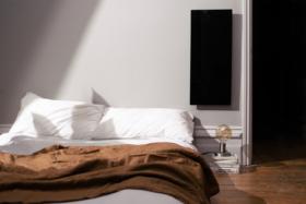 KOLEDA heater on a wall in a bedroom